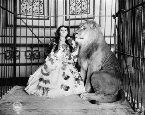 Lady Lion Tamer Caged with Lion